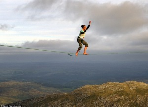 OK, this isn't me , but this is what slacklining can look like. I was doing this in Central with the lines connected between pillars. Not quite so high as this ... maybe next time!
