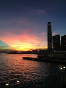 Sunset in Tsim Sha Tsui with the ICC towering above Victoria Harbour